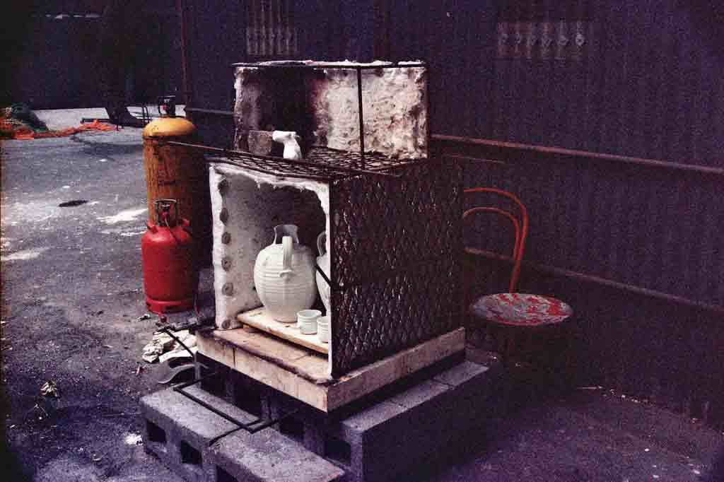 Photograph of kiln loaded with pots and ready for firing